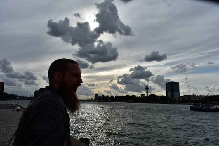 A cloudy day in Rotterdam. The husband is yawning. Euromast can be seen in the background.