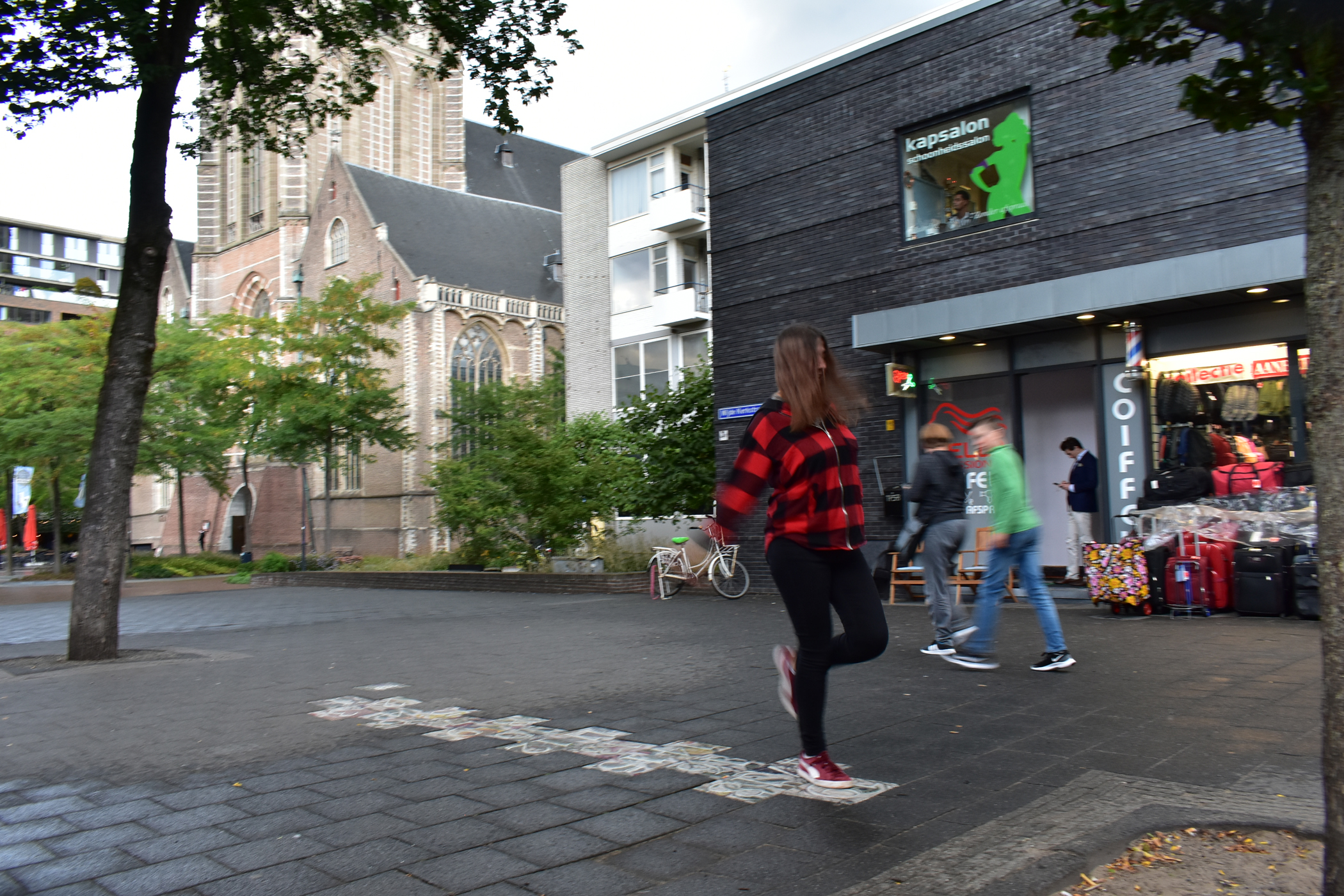 Playing hopscotch in the middle of Rotterdam town centre.