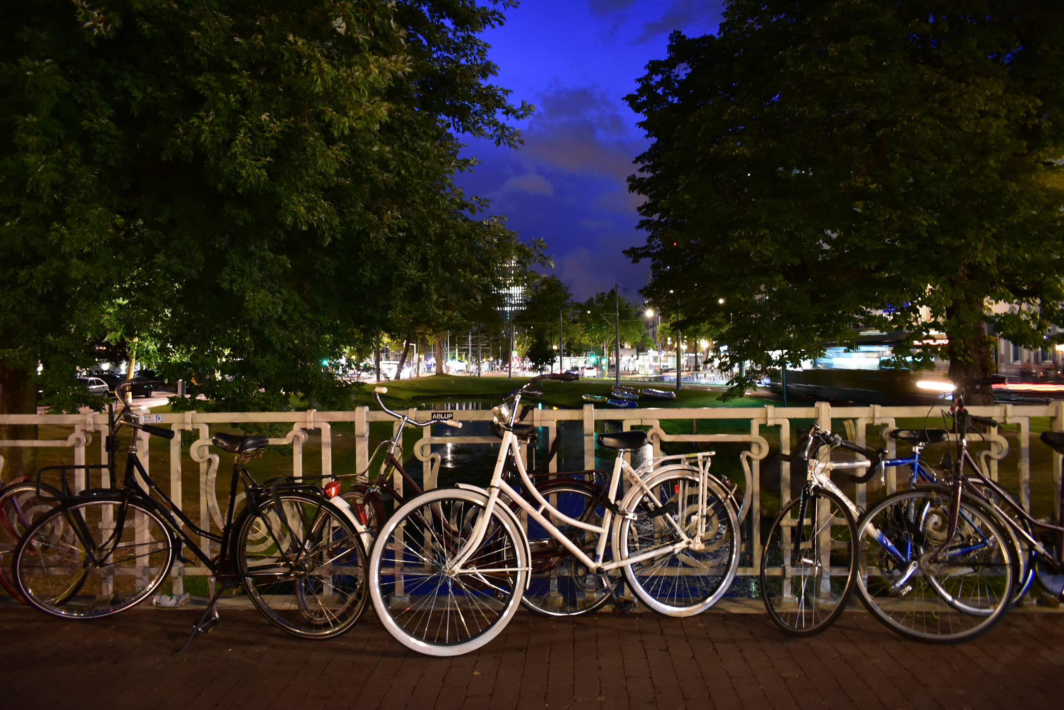 Night photo of bicycles on a bridge in Rotterdam.