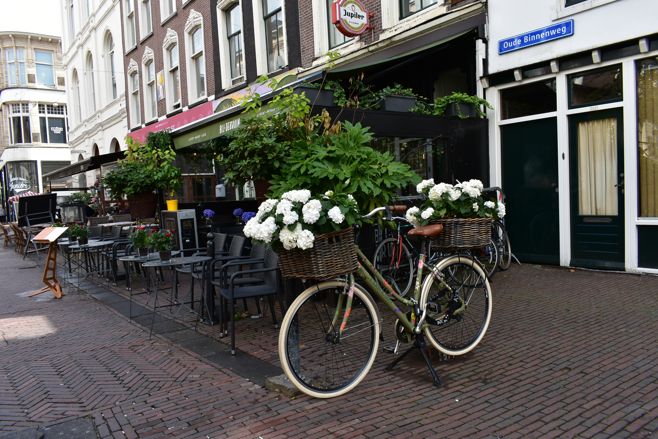 Iconic image of a town in Netherlands - a bicycle by a café terrace.