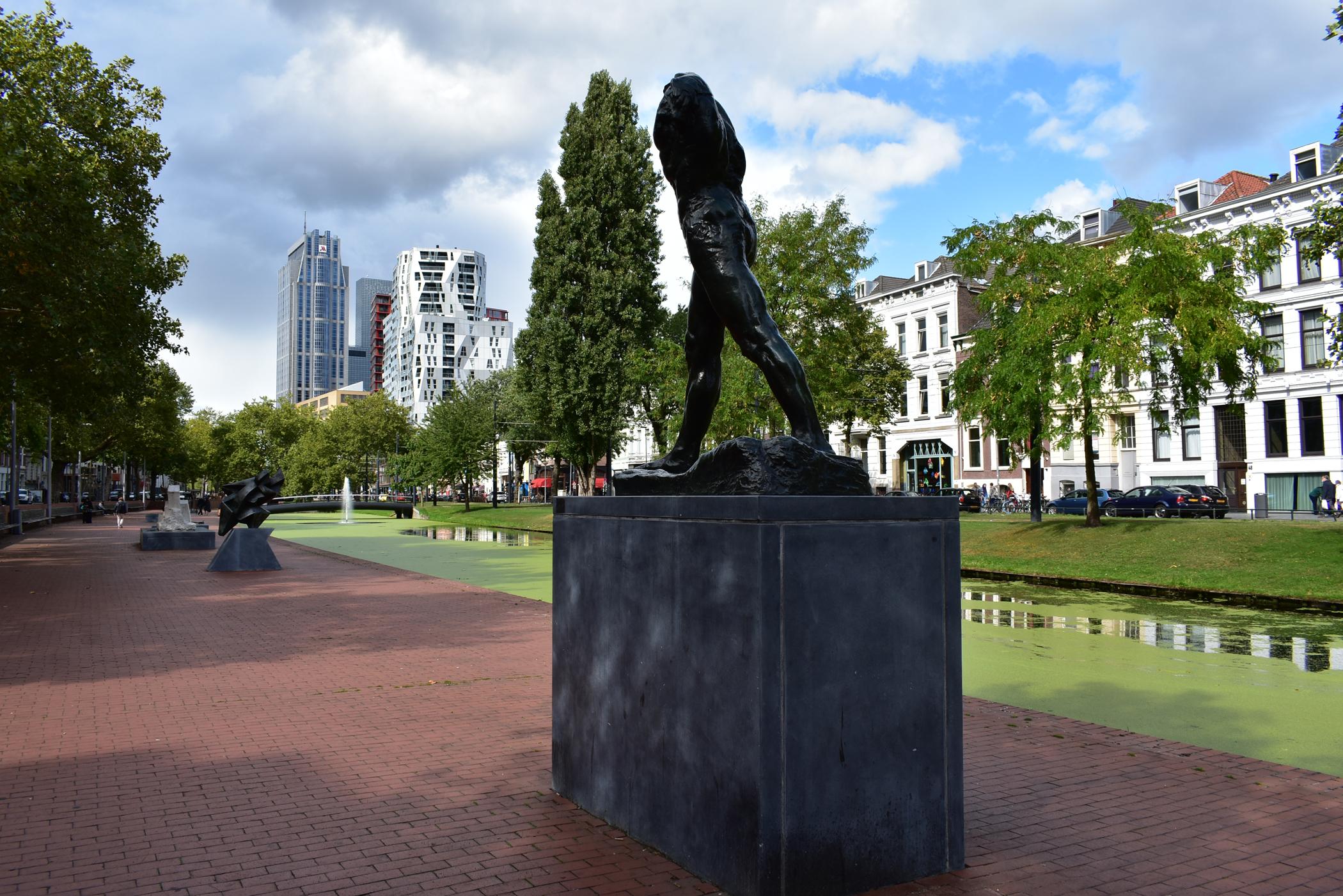 Rodin statue L'homme qui marche on the river bank in Rotterdam.
