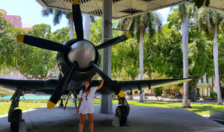 One of my favourite photos, me in front of an army plane at Granma Memorial in Havana.