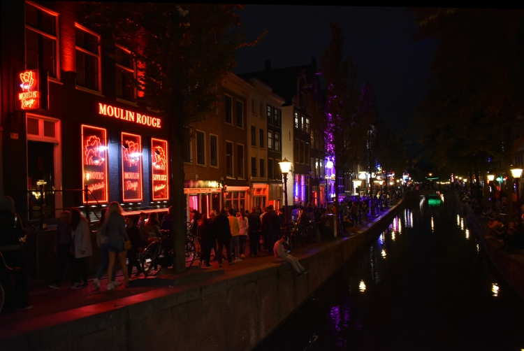 A night view of the beginning of the red light district and the part of the canal.