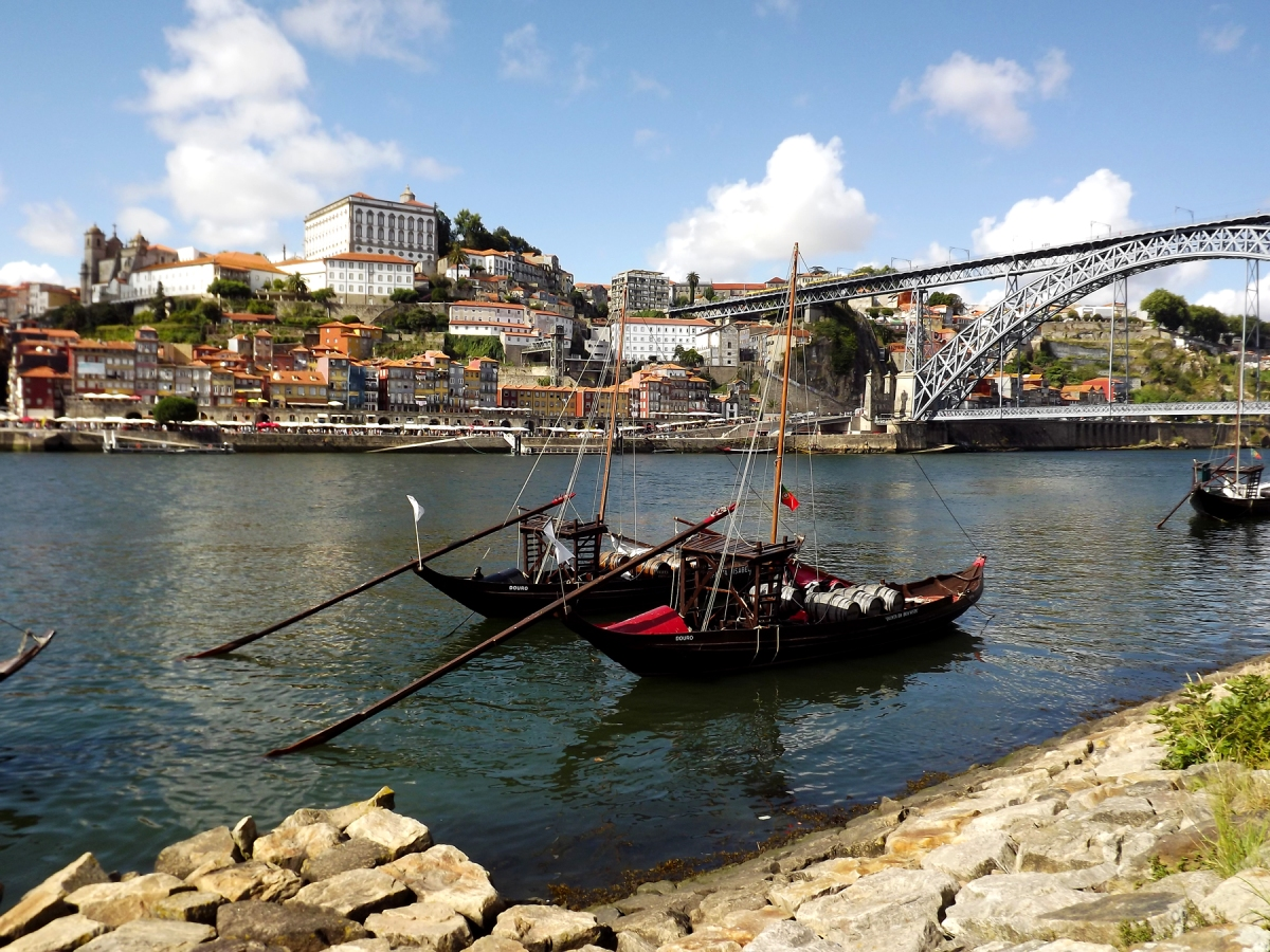 Two rabelo boast on river Douro by the famous Louis I bridge.