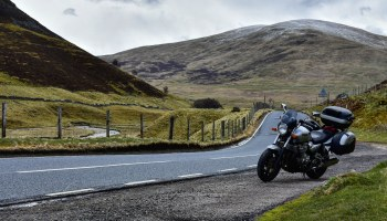 Our Yamaha XJR 1300 on the road passing through the Caringorms hills and mountains.