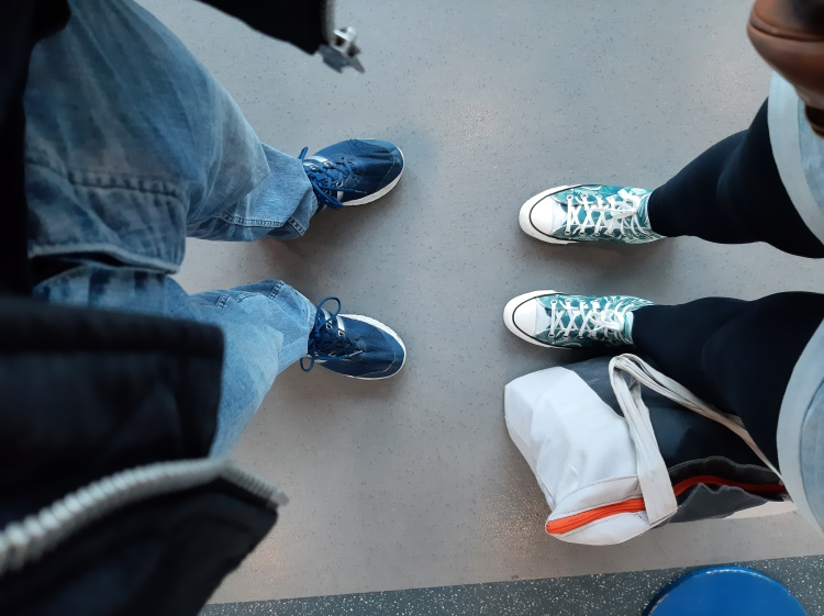From where I'm standing photo of our feet ready to finally board the plane. I love my Chucks (starke)