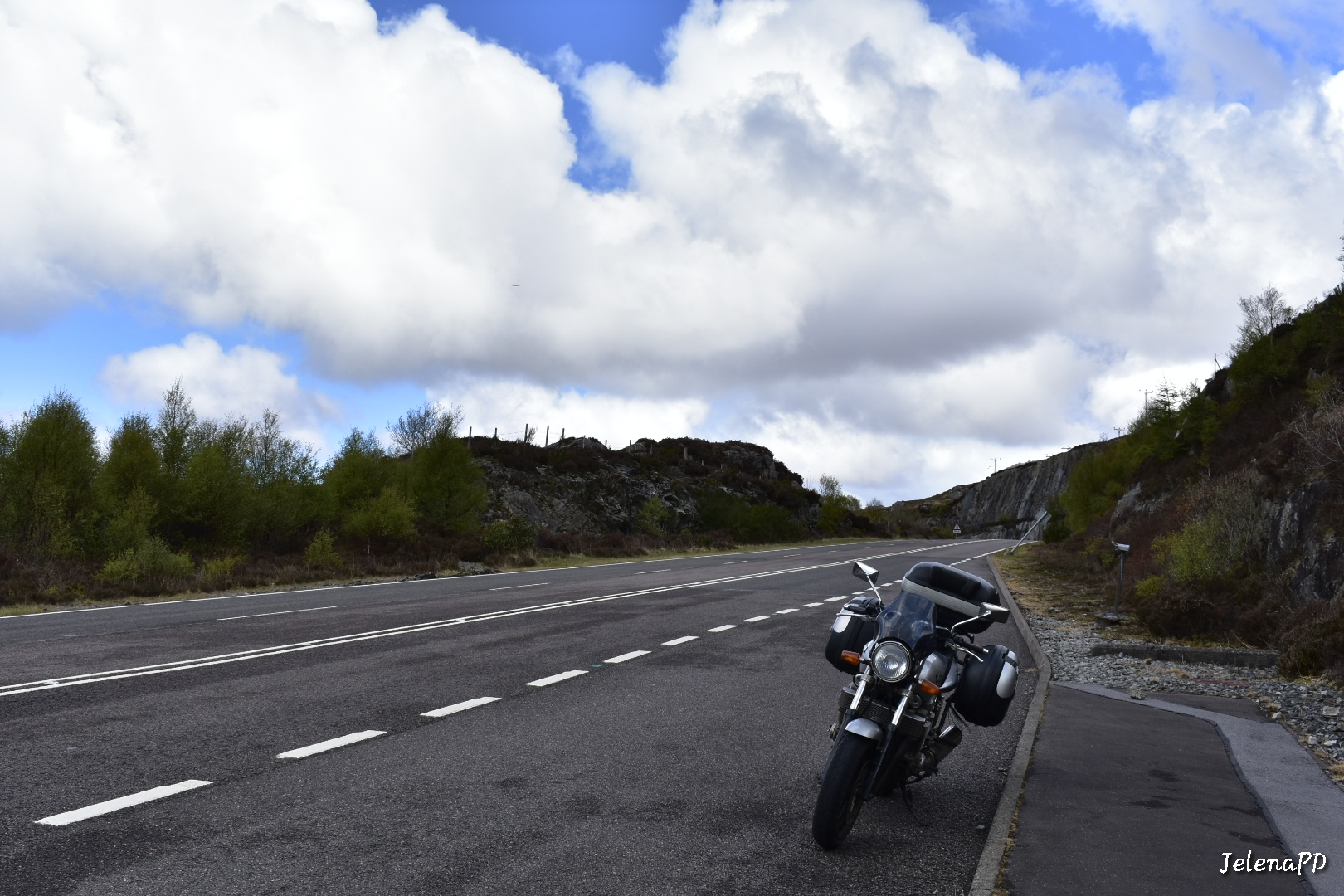 Our Yamaha XJR 1300 parked by the side of the A82, admiring the view.